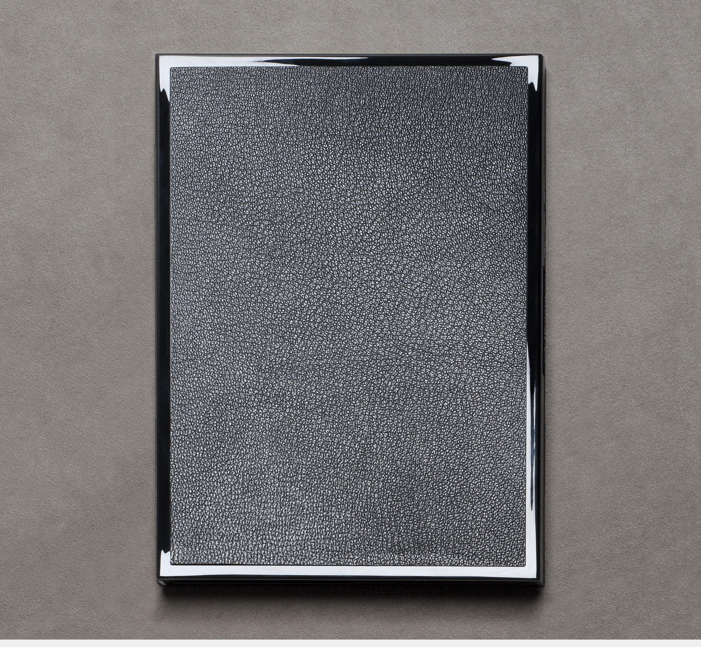 Le Carnet 12.19 Noir laque incrusté de cuir